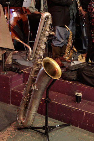 Jeffrey Barnes' implements of non-restraint, bass sax, soprano sax, and 20 oz Guinness.